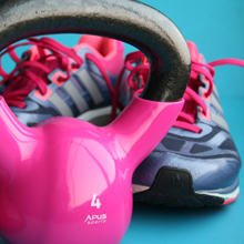 A Picture of a Kettle Bell and a Pair of Sneakers.