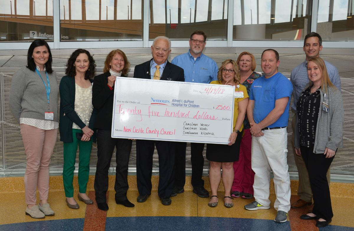 Council Members Ken Woods, Bob Weiner and Janet Kilpatrick presented a grant check today to help sup