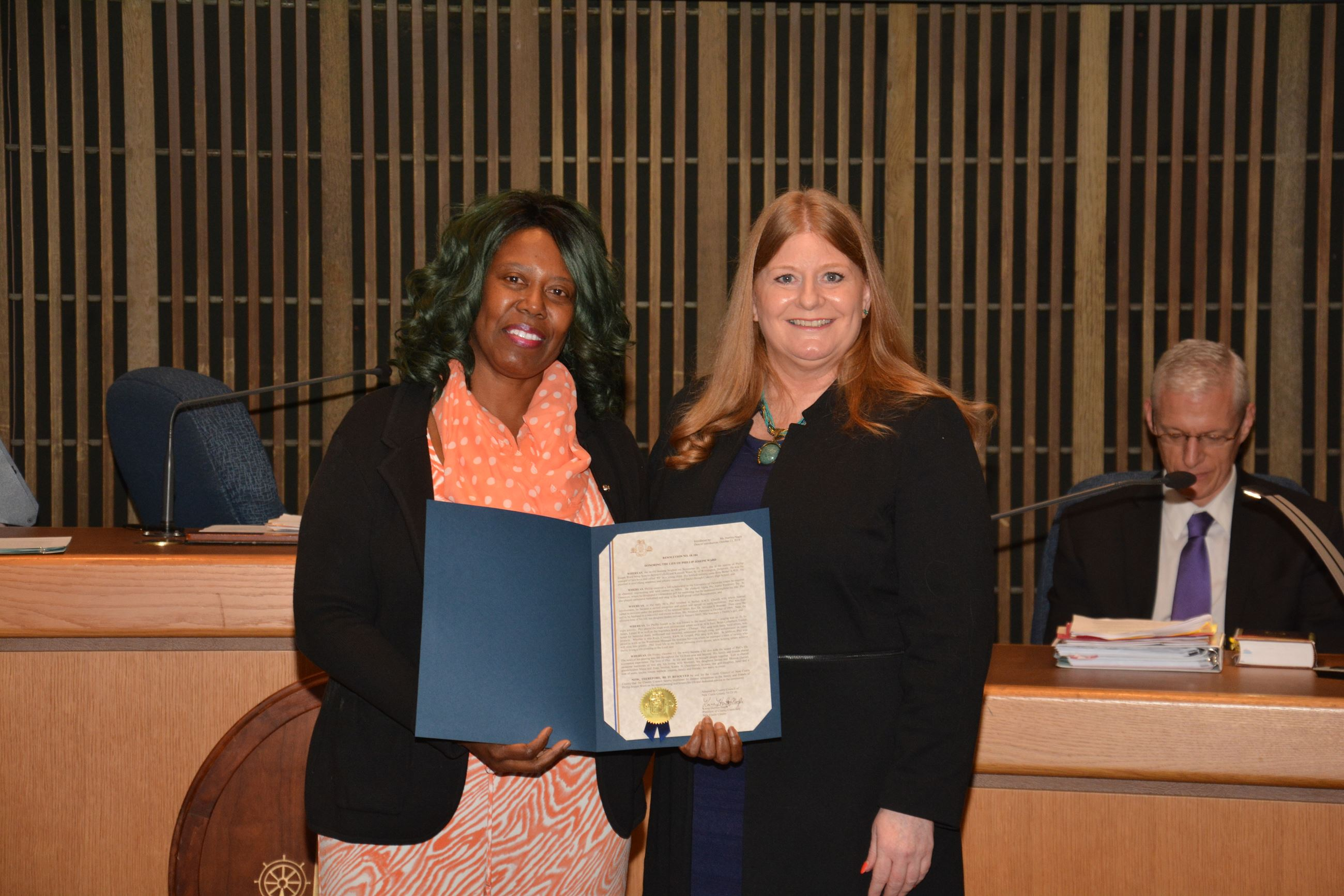 Council President Karen Hartley-Nagle presented a Council Resolution honoring the life of Phillip Jo