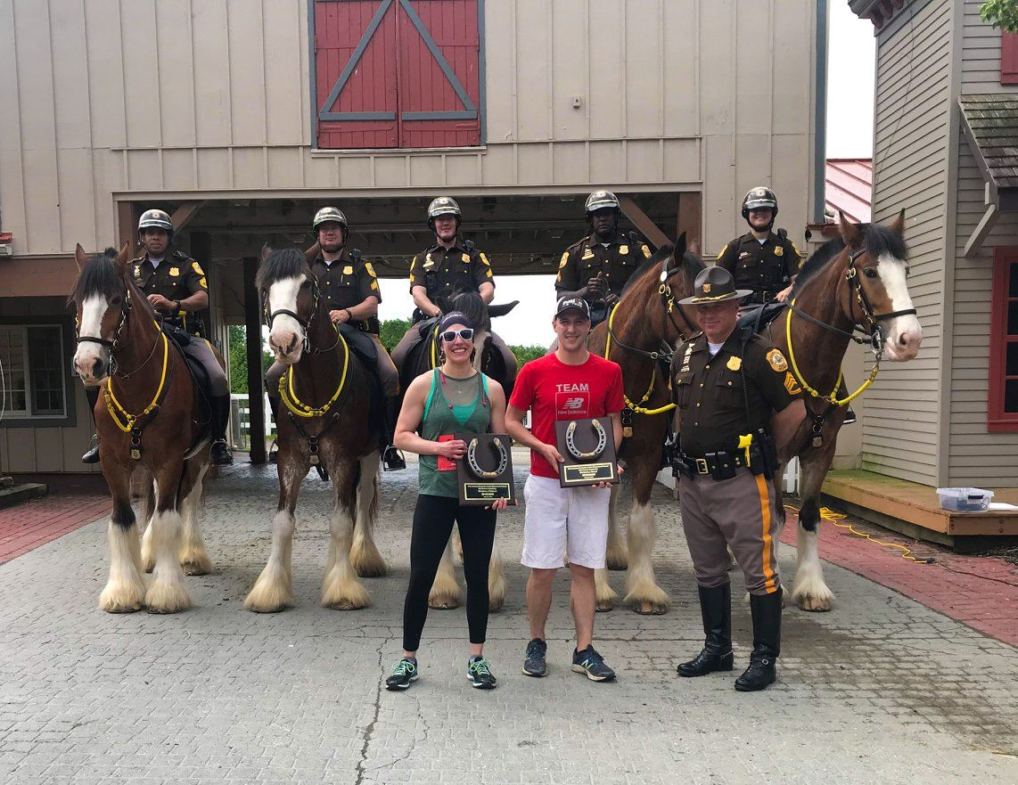 The race winners posing with the New Castle County Mounted Police