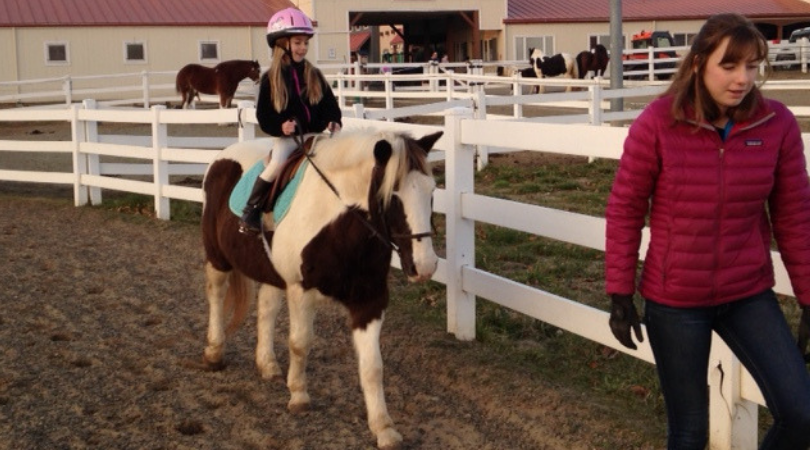 Girl riding a pony during her riding lesson at Carousel Park. Call (302) 995-7670 for details.